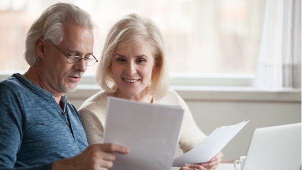 happy older couple reading page