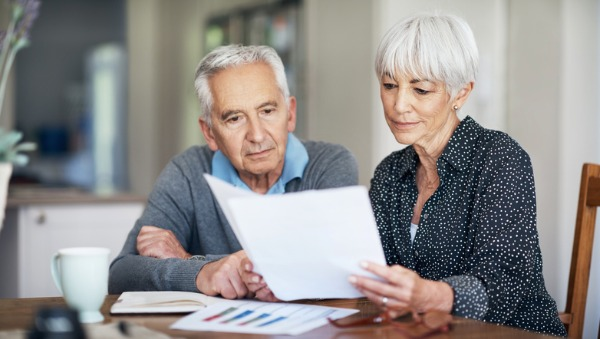 older couple looking at financial statements