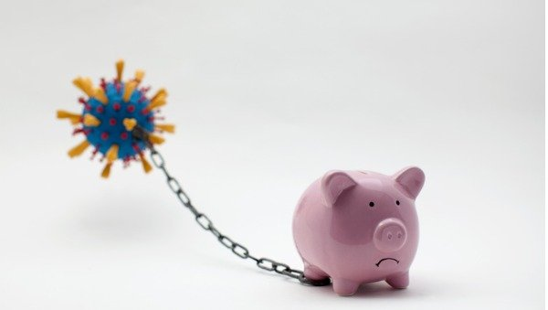 piggy bank restrained by virus