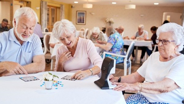 older people playing games in retirement home