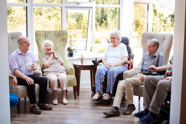 happy aged care residents sitting in lounch