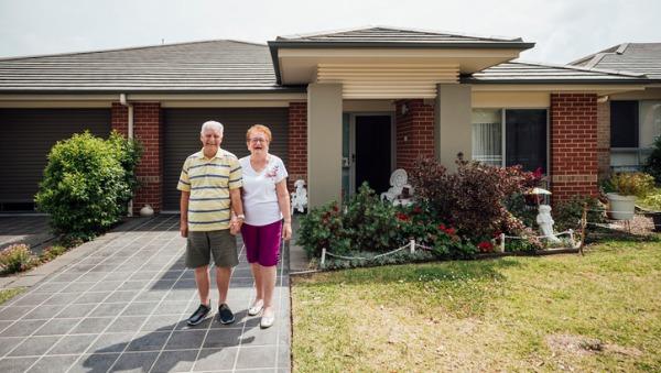 Older couple outside home