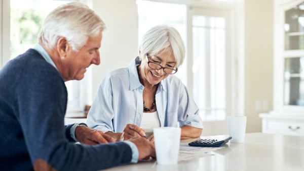 older couple looking at finances at table