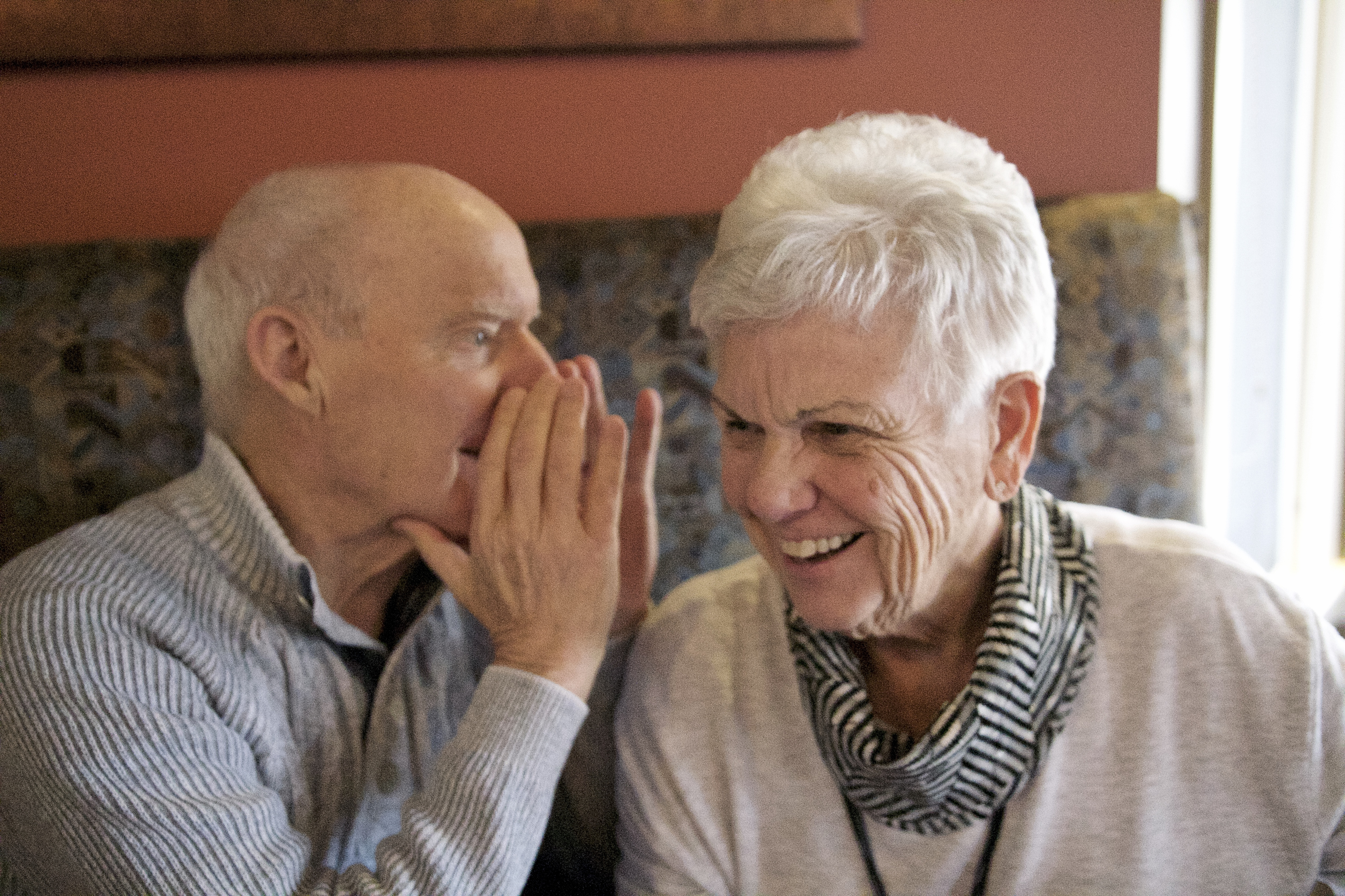 Two senior people talking to each other
