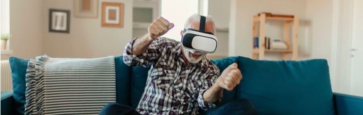 senior-man-experiencing-virtual-reality-eyeglasses-headset-picture-id1186885253