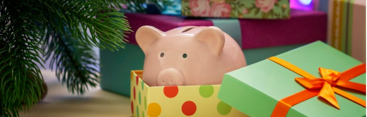 small-pink-piggy-bank-in-a-festive-box-symbol-of-the-new-year-under-picture-id1038045700